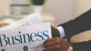 Man reading business section